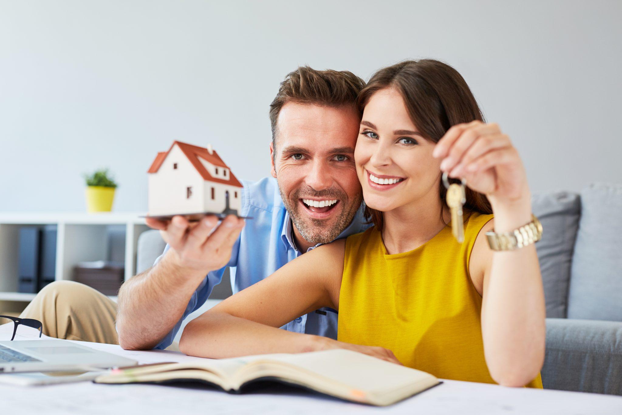 happy couple holdings keys to house